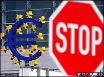 A euro symbol next to a Stop sign