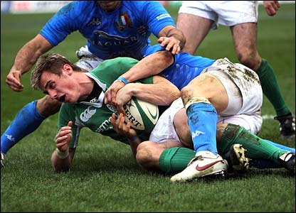 Ireland's Tommy Bowe is awarded a try despite Mauro Bergamasco's efforts to hold him up