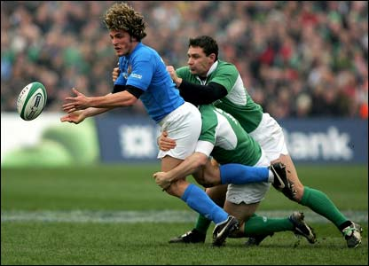 Italy's Mirco Bergamasco is tackled