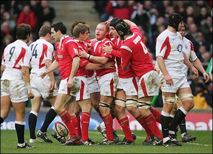 Wales celebrate scoring against England