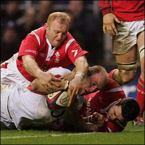 Lawrence Dallaglio drives over for a try in the second half