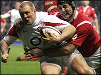 Mike Tindall holds off Ian Gough to score