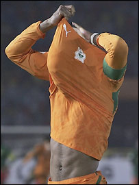 Ivory Coast striker Didier Drogba celebrates scoring the winning penalty