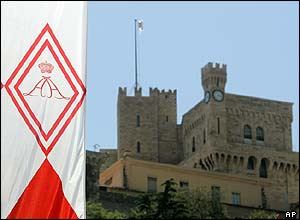 Flag flies with the new arms of Prince Albert II of Monaco beside the palace