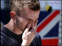 A young man weeps outside King's Cross