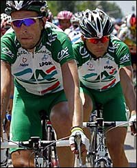 Christophe Moreau (left) and team Credit Agricole lead the peloton
