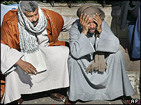 A distraught relative is comforted at Safaga, Egypt