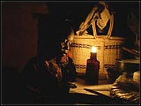 African boy doing his homework by candlelight (�Practical Action/Crispin Hughes')