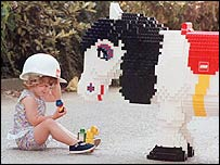 Young girl playing with Lego horse