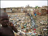 Children playing on a rubbish tip in Luanda