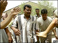 Bereaved men at Baghdad hospital