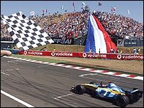 Fernando Alonso crosses the line to win the French Grand Prix
