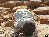 A seven-year-old boy crying after his home was demolished