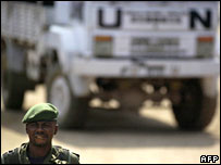 A Congolese soldier in front of a UN peacekeeping force truck