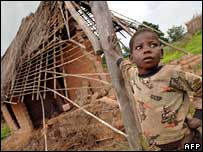 A child in front of a destroyed house in DR Congo's Katanga province