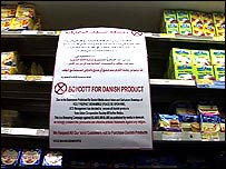 Boycott notice pinned to a half-empty shop shelf