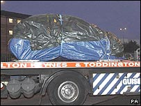 A car, believed to be hired by the bombers, is removed