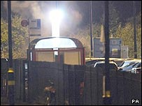 Smoke rises after a controlled explosion, early Wednesday, in Luton Station car park