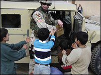 US troops hand out sweets to Iraqi children (photo: Hugh Sykes)