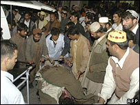 An injured victim being moved from blast site in Quetta