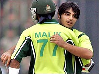 Salman Butt is embraced by Shoaib Malik after completing his century