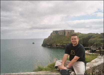 Lyn Sellers sent in this picture of her fiance Ross Pope in Tenby with the view of St Catherine's and the sea