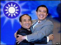 Taipei Mayor Ma Ying-jeou (R) and parliament speaker Wang Jin-pyng (L), hug each other, 2 July