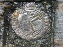 The coin was found embedded in the ship's keel