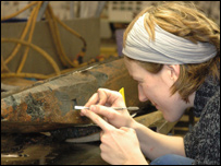 Angela Karsten working on the coin where she found it