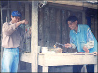 Hmong villagers weighing opium in Northern Laos