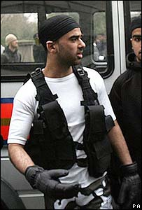 Omar Khayam dressed as a suicide bomber