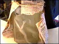 Alien model wrapped in newspaper