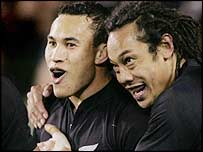 Rico Gear and Tana Umaga celebrate after the former scored the last try of the Test series