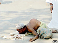 A beggar on a street in the outskirts of Dhaka