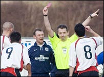 Iain Brines flashes the red card at Alex Williams