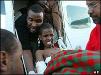 Mohamed Ada, 7 years old, scream as he is lifted of a Kenyan Red Cross plane in Nairobi