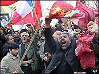 Protesters burn and tear European flags in Tehran