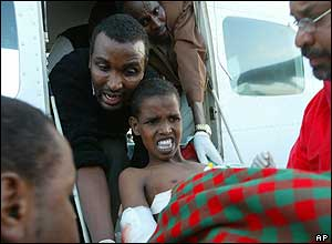 Mohamed Ada, 7, being taken off a Kenyan Red Cross plane