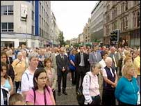 People standing in silence at Belfast city hall