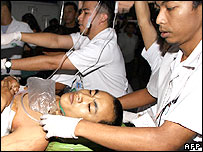 Thai paramedics rush a seriously injured soldier, Jeerasak Sae-lim, 22, for aid at a hospital in Thailand's restive southern Yala province, 29 January 2006.