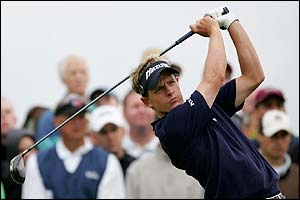 Britain's Luke Donald drives down the 12th