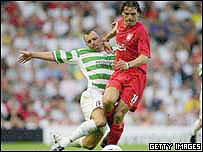 Fernando Morientes of Liverpool and Tommy Holmes of TNS (left)