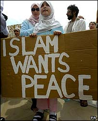 Muslim girl with banner calling for peace