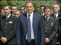 Tony Blair and police officers in the Downing Street garden