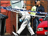 Police and forensic officers search a house on Colywn road, in the Beeston area of Leeds