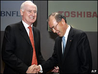 Chief Executive of BNFL Mike Parker (left), and Japan's Toshiba Corp. President and CEO Atsutoshi Nishida