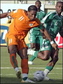 Didier Drogba shadowed by Nigeria defender Joseph Enakahire