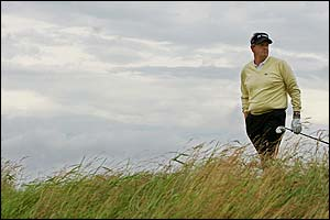 Scotland's Colin Montgomerie wanders to the next tee