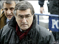Journalist Hasan Cemal enters the court in Istanbul