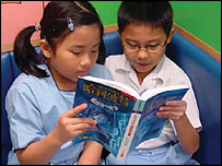 Two children reading a Chinese edition of Harry Potter. Picture courtesy of Waterstones